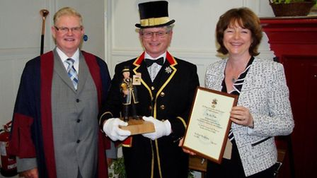 Town crier Jim Weeks celebrating his 30 years' service. Pic: Graham Hobbs
