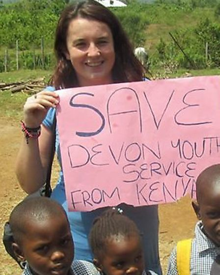 Christi Kelly pictured with children in Kenya.