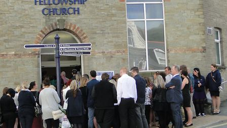 Mourners spilled out on to the High Street as more than 300 people gathered for the memorial service