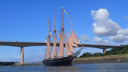 The Katheleen and May makes her way up the Torridge to Bideford, as seen from one of two boats from