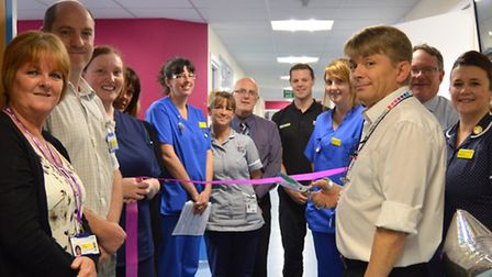 Kevin Marsh, director of nursing, performs the official opening of Lundy Ward in front of staff and