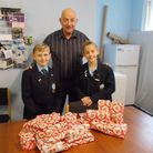 Bella and Henry Richards with Harbour chairman Roger Levick.