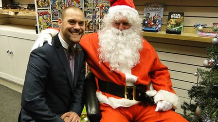 James Taylor-Short, of Bill and Taylor's Opticians in Barnstaple, with Father Christmas.