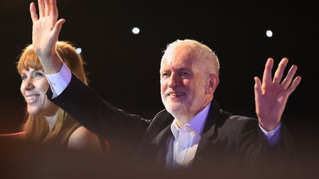 Labour Party leader Jeremy Corbyn and shadow education secretary Angela Rayner acknowledge supporter