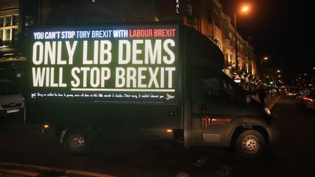 A van with a message from the Liberal Democrats is driven past the Grand Central Hall in Liverpool w