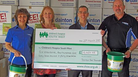 Sarah Stott from Childrens Hospice South West with members of staff from Dainton's self storage.