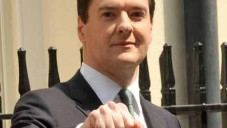 22/06/2010 PA File Photo of Chancellor of the Exchequer George Osborne carrying the famous old minis