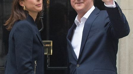 Prime Minister David Cameron and wife Samantha arrive at 10 Downing Street after the election put hi
