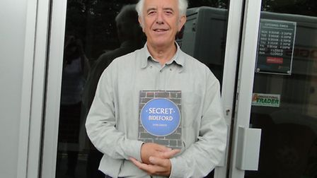 Peter Christie, pictured with a copy of his new book revealing some lesser-known facts about Bidefor
