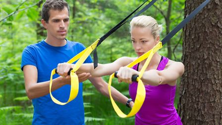 Training with fitness straps outdoors. Picture: Getty Images/iStockphoto