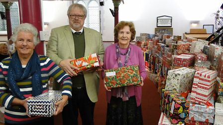 June Redfern of International Aid Trust, the Reverend Donald Macalister, and shoebox coordinator Syl