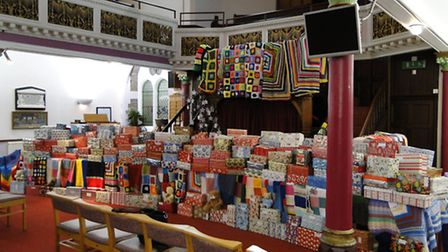 The collection of shoeboxes and knitted blankets at Christ Church in Barnstaple.