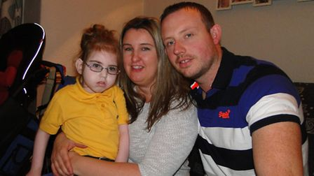 Emily Carey, five, pictured with mum Becky and dad Phil, will be turning on Bideford's Christmas lig