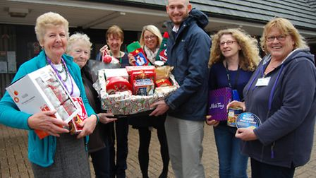 Gazette reporter Elliot and Sarah (middle) hand over your donations to foodbank volunteers