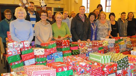 Volunteers at Grosvenor Church with just some of the Christmas shoeboxes