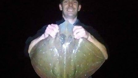 Dan Redmore with his fine small-eyed of 11lb 14oz, caught from a North Devon mark