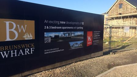 The hoarding advertising the new homes at Rolle Quay
