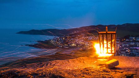 The beacon blazing atop Potters Hill at Woolacombe, organised by the National Trust. Picture: Joshua