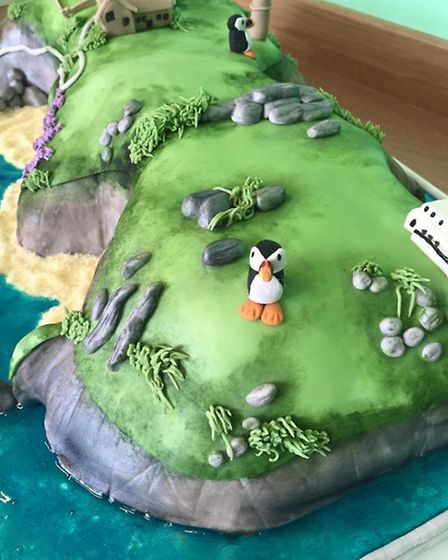 The cake version of Lundy Island by Kirsty Robb of Crumb Creations.