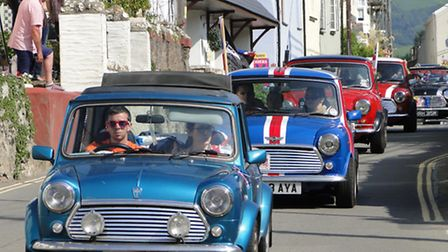 The Minis make their way through Combe Martin in 2013.