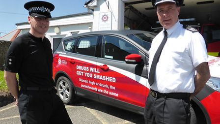 Torridge sector inspector Phil Gray and fire service area manager Neil Blackburn are pictured with o