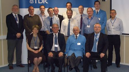 TDK-Lambda managing director Adam Rawicz celebrates the 50th anniversary with UK managers and direct