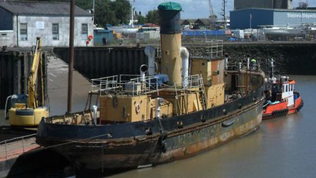 Heritage steam ship, SS Freshspring is towed along the river Severn in Gloucestershire from Newnham-