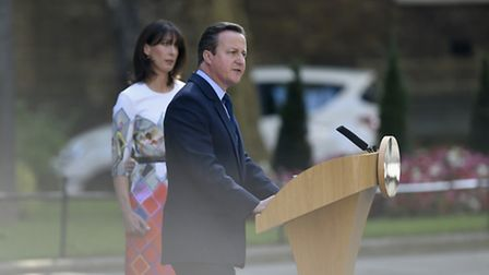 Prime Minister David Cameron speaks outside 10 Downing Street, London, with wife Samantha where he a