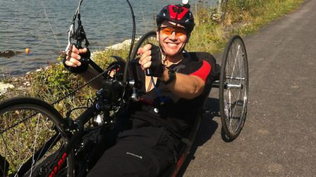 Simon Mackie on his leighweight hand bike, purchased in part by an Aspire grant.