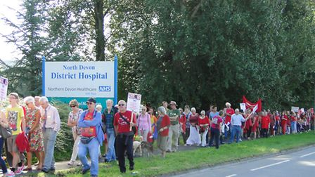 An estimated 500 people took part in a silent protest against cuts to services at North Devon Distri