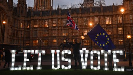 People's Vote campaigners outside the Houses of Parliament. Photograph: Victoria Jones/PA.