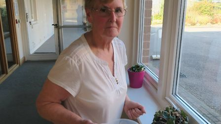 Val Smith helps with everything from watering plants to chatting to patients.