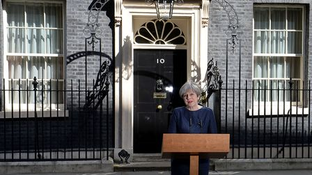 Prime Minister Theresa May announces a snap general election on June 8 outside 10 Downing Street. Pi