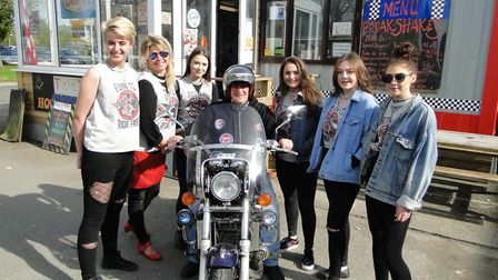 The Tooters Diner girls are ready for their bike show on Sunday.
