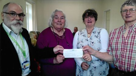 Stephen Johns, Penny Hoyle, Yvonne Taylor and Jim Weeks at the cheque presentation in Bideford Hospi