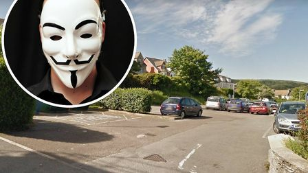 Some of the youths were wearing 'Anonymous Masks' like the one pictured inset, at the robbery in Oxf