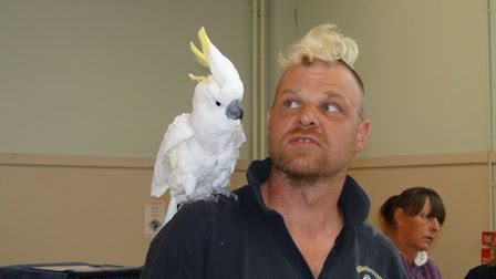 Nick Spiller with Snowball, a seven-year-old sulphur-crested cockatoo. Picture: Tony Gussin