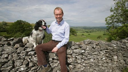 Liberal Democrats leader Tim Farron and his 5-year-old Springer Spaniel Jasper during a walkabout wi