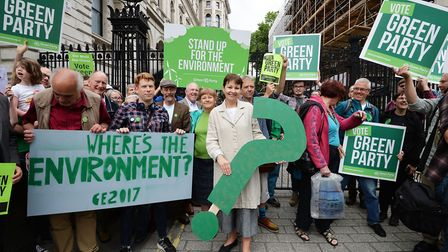 Green co-leader Caroline Lucas (front) with supporters during a Green Party poster launch outside Do