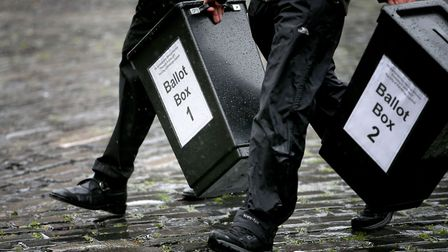 Election staff deliver signage and ballot boxes to a polling station Picture: Jane Barlow/PA Wire