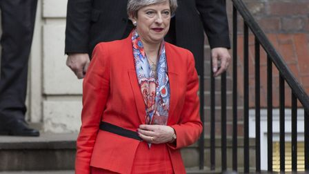 Prime Minister Theresa May leaves Conservative Party HQ after she said Conservatives will act to ens