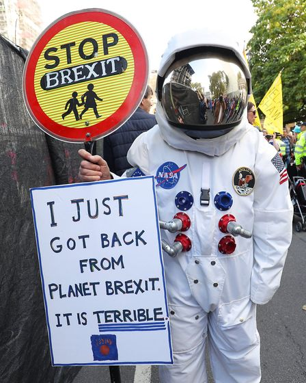 Campaigners at the People's Vote march in London as MPs vote on Boris Johnson's Brexit deal. Photogr