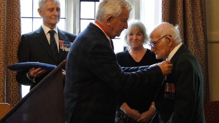 Dennis Young is presented with his Legion d'Honneur medal by Alain Sibiril, watched by Lt Col Mike R