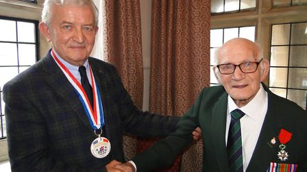 Honorary French Consul Alain Sibiril with Dennis Young after presenting him with the Legion d'Honneu