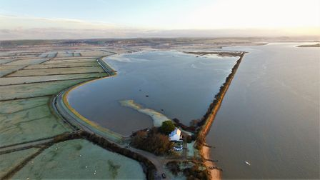 Aerial views show just how close the waters at Braunton Marsh are coming to the White House. Picture