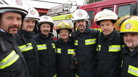Neil (left) with fire fighters at Bideford doing Movember in 2011.