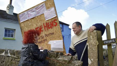 A passerby signs the petition to save the Tarka Hens. Picture: YellowBunny.Media