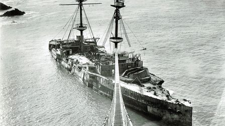 HMS Montagu and the rope walk for the salvage crew. HMS Montagu grounded on rocks surrounding the I