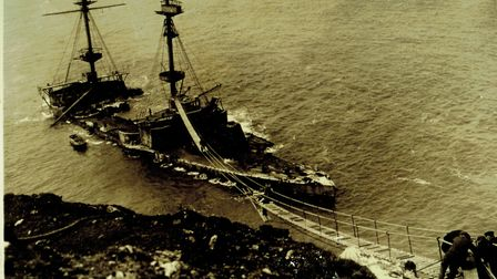 HMS Montagu and the rope walk for the salvage crew. HMS Montagu grounded on rocks surrounding the Is