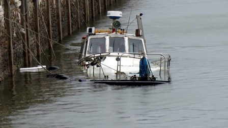Emergency services are dealing with an oil spill on Friday evening after a boat sank at Bideford Qua